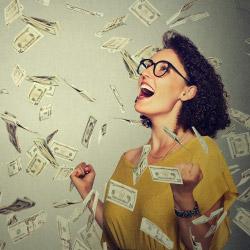 Happy woman pumping fists celebrates success under falling money